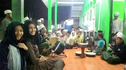 With my host sister and the boys singing/playing to the Qur'an.