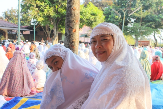 Nadila and Bunda in their prayer clothes at the mosque. (Eid-ul-Adha)