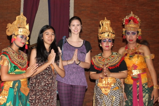 With the dancers.